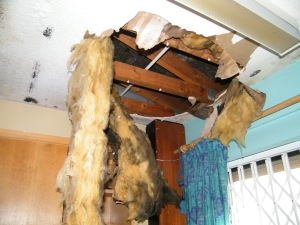 One of the office ceilings ripped down by vandals